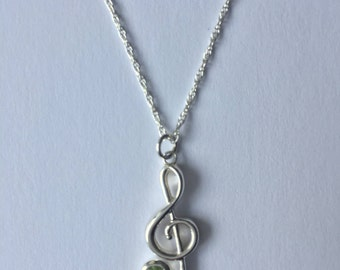 Treble Clef Music Necklace / Sterling silver treble clef with Peridot