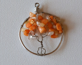 Wire-wrapped Tree of Life pendant or sun catcher with orange and white translucent stone beads on silver wire