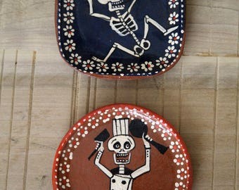2 Hand painted Day of of the Dead Clay Dishes, One Dancing Skeleton, One Chef Skeleton
