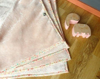 Baby in pink and liberty comforter blanket