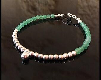 Aventurine gemstones and sterling silver charm bracelet