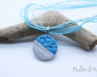 Blue polymer clay and wood on the Ribbon pendant necklace