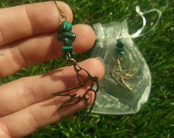 Earrings with Malachite Green swallows. Bronze swallows with Malachite beads.