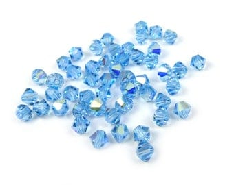 50 x toupies cristal Swarovski®  4 mm AQUAMARINE AB