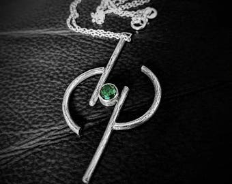 Wood grain silver rune pendant with green CZ