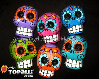 Mexican skulls, Day of the dead. Paper mache. Mexican folk art. Skulls of colors, day of the dead, Papelmache. Mexican folk art.