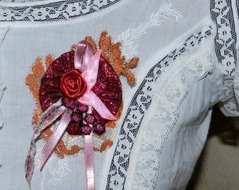 Burgundy and pink brooch with lace