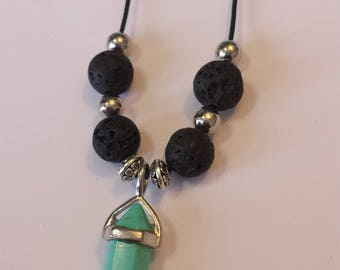 Turquoise crystal pendant with lava stone on elastic rope