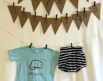 Bumps shirt, black and white stripped shorts