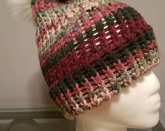 Multicolored winter hat with faux pompom