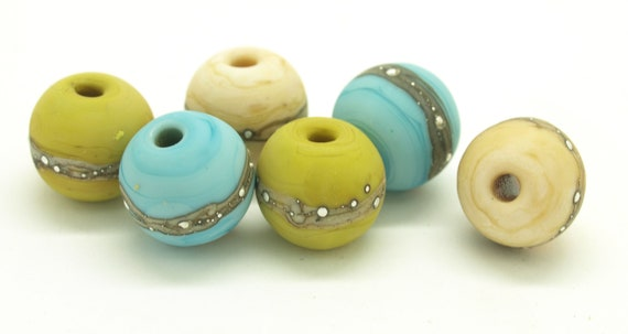 Pistachio, turquoise and ivory pairs with silvered ivory.