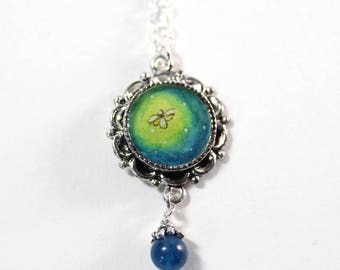 The Firefly, a Hand-painted Watercolor Necklace in Small Silver Circle with Lapis Bead