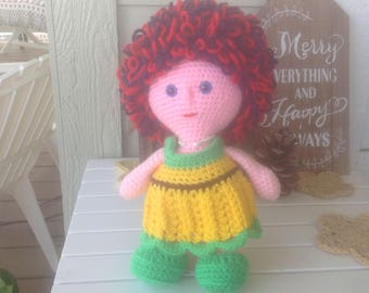 Pink doll with yellow/green dress