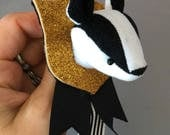 Hufflepuff Pride Badger pin brooch faux taxidermy mounted head soft sculpture wearable art Hogwarts House mascot stuffed animal Harry Potter