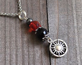 Silver Sun Necklace Black Micro Faceted Onyx Gemstone Bead, Hematite & Red Glass Bead Soleil Pendant