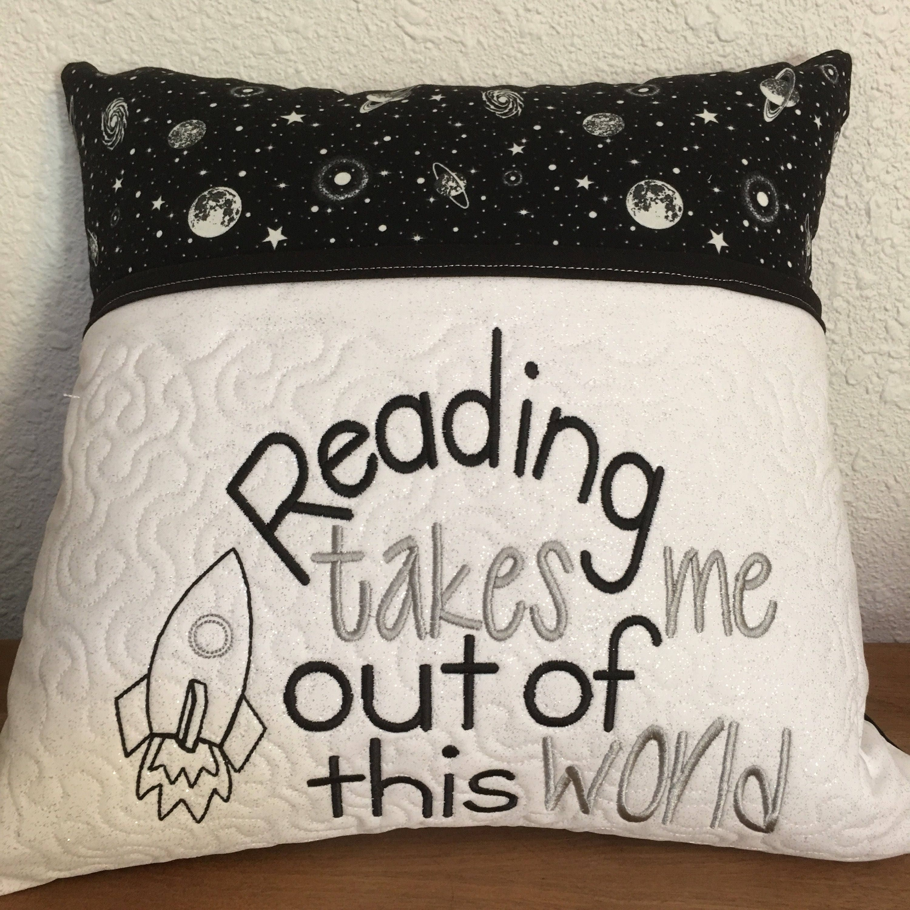 Embroidery design reading takes me out of this world