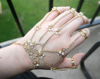 HALF OFF ... Slave bracelet , made of faux  Pearls with rhinestones  -Very Elegant and Classy