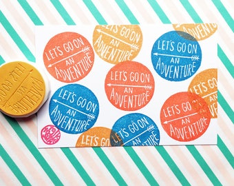 let's go on an adventure stamp. circle hand carved rubber stamp. hand lettered stamp. scrapbooking. gift wrapping. birthday crafts
