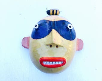 Bandit man w/bumblebee clay wall sculpture