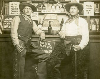 Cowboys at WILD WEST BAR Saloon Having a Drink While Holding Their Rifles Novelty Arcade Studio Photo Postcard circa 1910 Seattle Washington