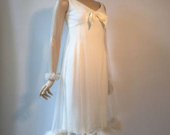 Vintage 1960s Jean Of California empire line babydoll cocktail or wedding dress in white crepe with swingy ruffled tulle overlay