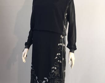 1920s vintage black silk flapper dress with monochrome tabard style beading and sheer sleeves