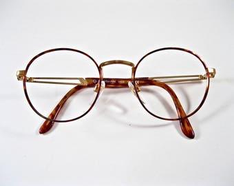 90s circular eyeglass frames. Sergio Tacchini tortoiseshell copper frames. no lenses 48-20.