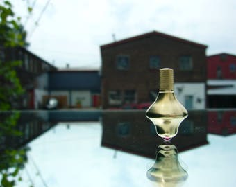 Manually Machined Brass Pocket Spinning Top (Ruby Tip)