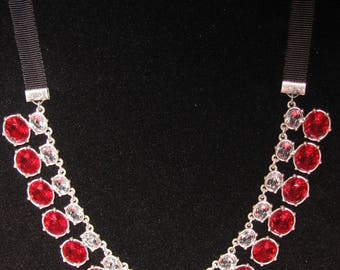 Avon Ruby  Necklace  Clear and Ruby Red Stones on a Silver tone Background