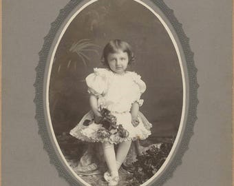 Pretty Image of a little Girl Holding Roses