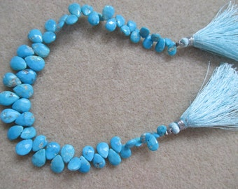 Faceted turquoise pear shape gemstones