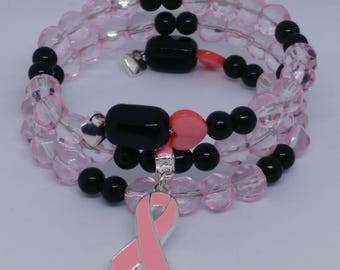 Pink breast cancer awareness bracelet, glass beads, pink heart, memory wire.