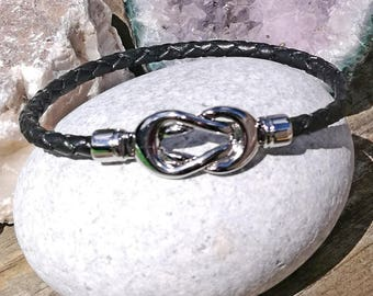 Pandora-style leather and silver plated infinity charm bracelets. Magnetic clasp.4mm Braided leather in vintage brown, black and natural.