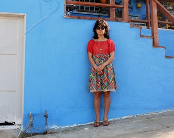 1960s colorful sheer puff sleeve mini dress.