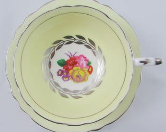 Paragon Yellow Tea Cup and Saucer with Flowers and Silver Trim, Fine Bone China