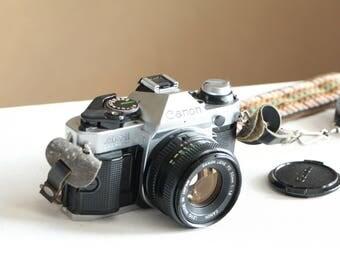 Vintage Canon AE-1 camera and flash Speedlite 199A / camera accessory bundle