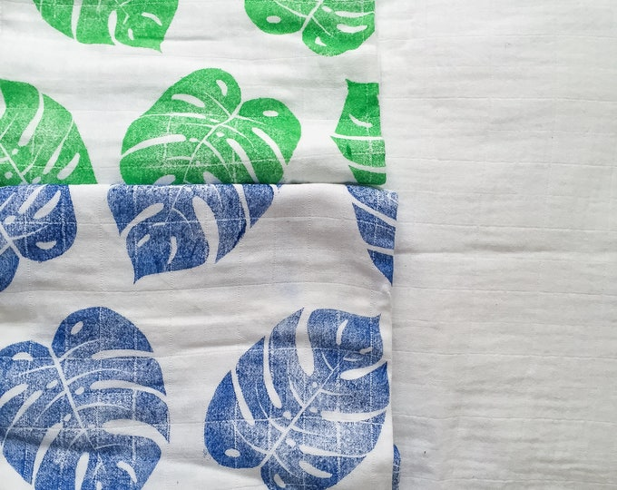 Featured listing image: Philodendron leaf handprinted baby blanket, indigo muslin swaddle blanket, blue muslin swaddle blanket, blue baby shower, blue baby gift