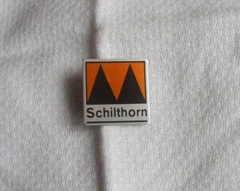 Vintage SCHILTHORN Aluminium Square Badge / Cap Pin