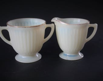 Custard Glass Creamer and Sugar Bowl, UV Green Light Bulb Red Circa 1910 to 1920 Uranium Glass