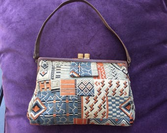 1920s hand embroidered handbag with leather trim,lucite clasp and three compartments