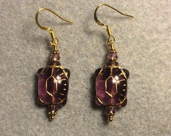 Purple Czech glass turtle bead earrings adorned with purple Chinese crystal beads.