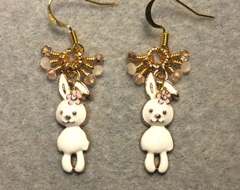 Off white, pink, and gold enamel rabbit charm earrings adorned with tiny dangling white, pink, and gold Chinese crystal beads.