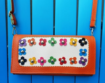 Gently used orange floral studded faux leather clutch or wallet with removable wrist strap and cross-body strap, boho, gypsy, bohemian