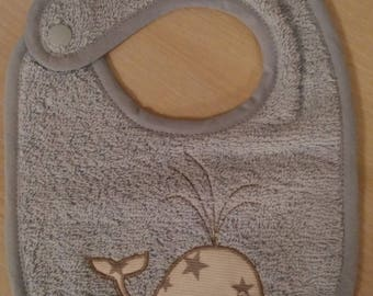 light blue towel with embroidered whale bib
