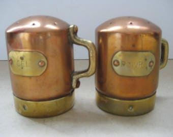 Vintage French pepper and salt shaker in copper and brass.