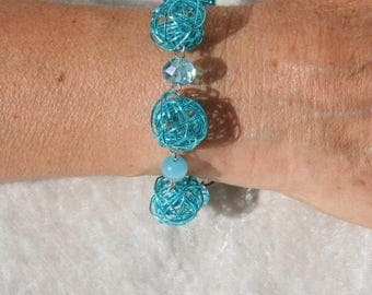 Turquoise blue bracelet with metal beads