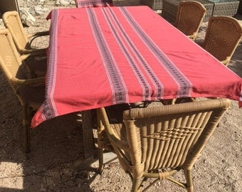 Large tablecloth with 12 matching napkins. Red cotton with geometric design. 1960s, good condition, French.