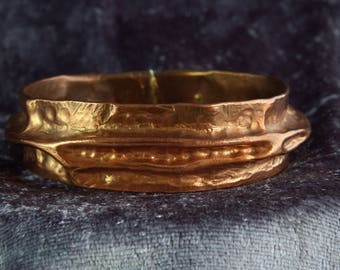 A unique handmade hammered polished copper bracelet.