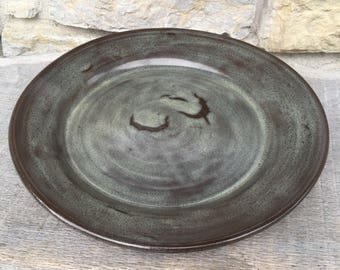 Large Pottery Serving Platter or Charger Plate on dark clay