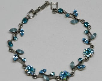 Lovely silver tone and blue crystals bracelet
